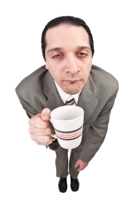 Tired Businessman With Coffee
